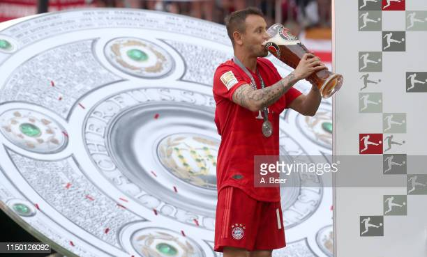Rafinha of FC Bayern Muenchen drinks beer in celebration of the German Championship title after the Bundesliga match between FC Bayern Muenchen and...