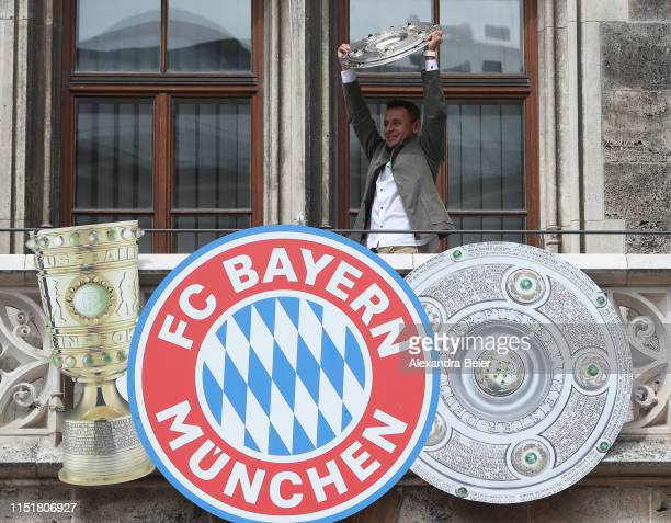 Rafinha of FC Bayern Muenchen lifts the Bundesliga trophy in celebration of the Bundesliga title and the German Cup title for the season 2018/19 on...