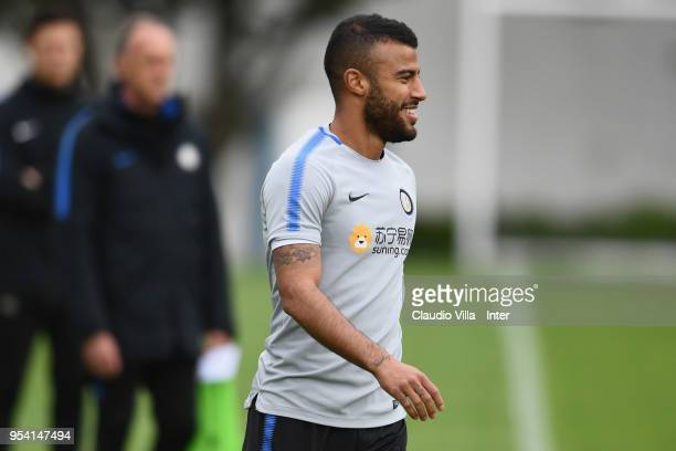 Rafinha of FC Internazionale smiles during the FC Internazionale training session at the club's training ground Suning Training Center in memory of...