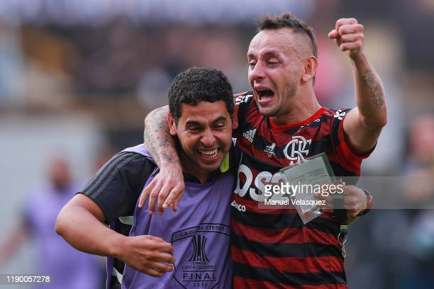 Rafinha of Flamengo celebrates the victory with a teammate after winning the final match of Copa CONMEBOL Libertadores 2019 between Flamengo and...