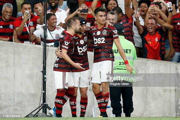 Rafinha of Flamengo celebrates with teammates Everton Ribeiro and Reinier after the own goal of Danilo Barcelos of Vasco during a match between...