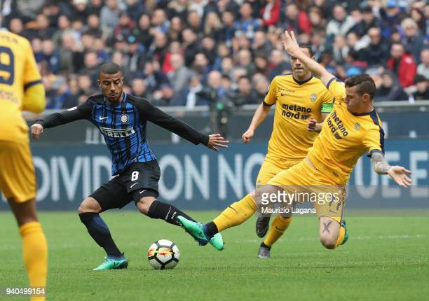 Rafinha of Inter competes for the ball with Marcel Buchel during the serie A match between FC Internazionale and Hellas Verona FC at Stadio Giuseppe...