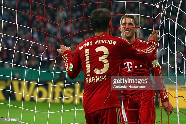 Rafinha of Muenchen celebrates scoring the 5th team goal with his team mate Nils Petersen during the DFB Cup second round match between FC Bayern...