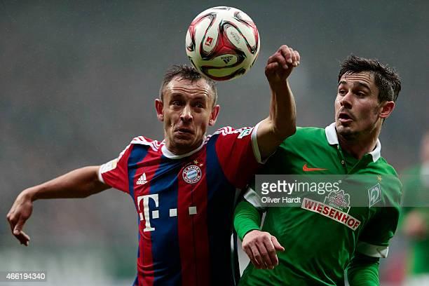 Rafinha of Munich and Fin Bartels of Bremen compete during the First Bundesliga match between SV Werder Bremen and FC Bayern Muenchen at Weserstadion...