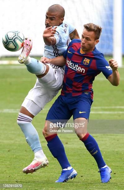Rafinha of RC Celta Vigo wins the ball from Arthur of FC Barcelona during the Liga match between RC Celta de Vigo and FC Barcelona at AbancaBalaídos...