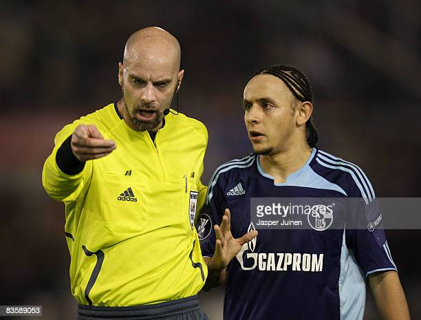 Rafinha of Schalke 04 argues with referee Stefan Johannesson during the UEFA Cup group A match between Racing Santander and Schalke 04 at the El...