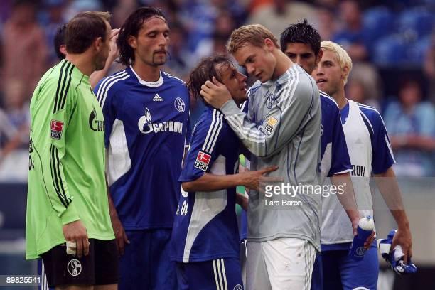 Rafinha of Schalke celebrates with goalkeeper Manuel Neuer of Schalke after winning the Bundesliga match between FC Schalke 04 and VfL Bochum at the...