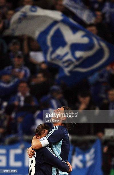 Rafinha of Schalke celebrates with team mate Marcelo Bordon afer winning the UEFA Champions League Group B match between Schalke 04 and Rosenborg...