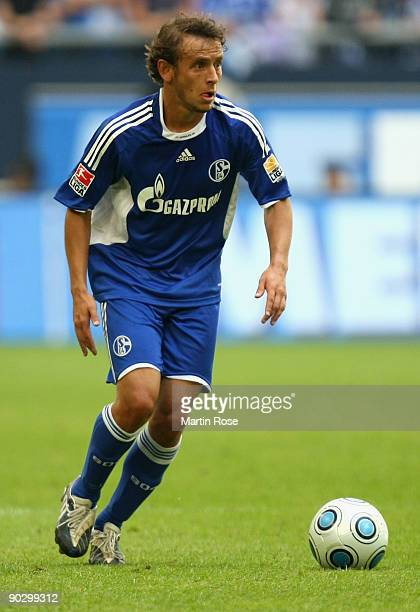 Rafinha of Schalke runs with the ball during the Bundesliga match between FC Schalke 04 and SC Freiburg at the Veltins Arena on August 29 2009 in...
