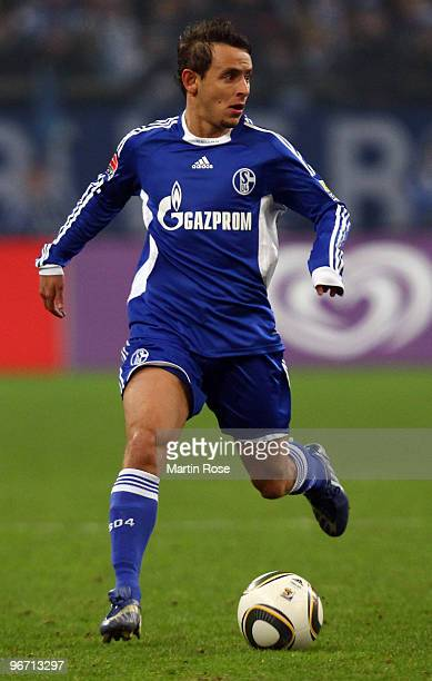 Rafinha of Schalke runs with the ball during the Bundesliga match between FC Schalke 04 and 1 FC Koeln at the Veltins Arena February 14 2010 in...