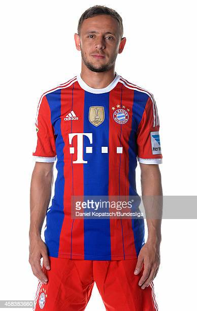 Rafinha poses during the FC Bayern Muenchen Team Presentation for DFL on August 9 2014 in Munich Germany