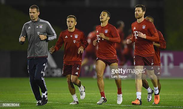 Rafinha Thiago and Xabi Alonso are seen during a training session at day one of the Bayern Muenchen training camp at Aspire Academy on January 6 2016...