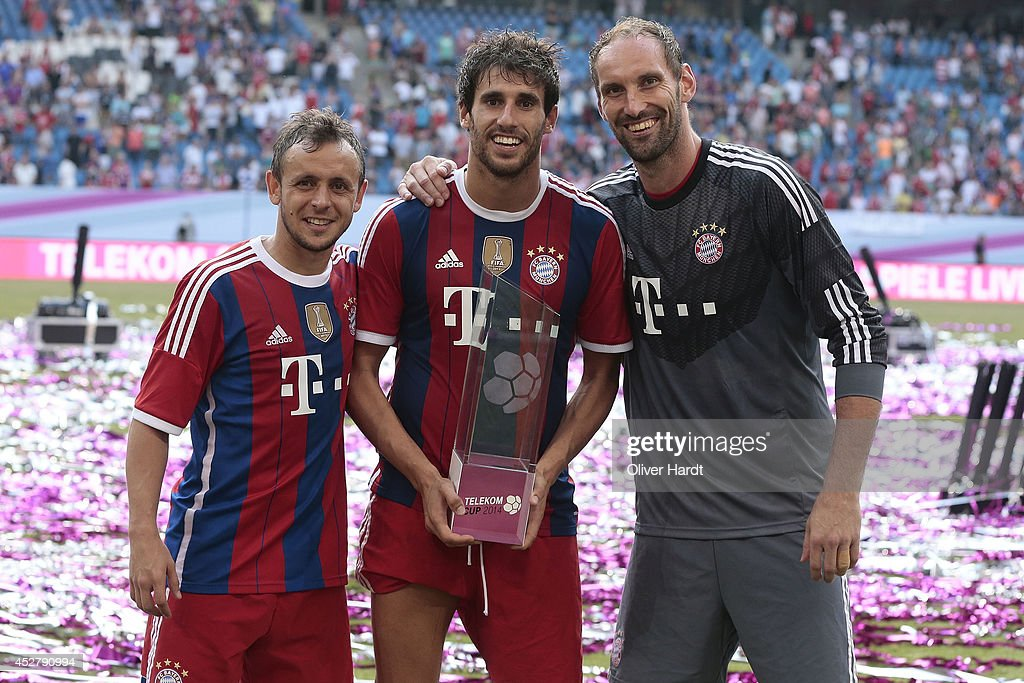 Rafinha,Tom Stark and Javi Martinez (L-R) of Munich celebrates with the trophy after the Telekom Cup 2014 Finale match between FC Bayern Muenchen and Borussia Moenchengladbach at Imtech Arena on July 27, 2014 in Hamburg, Germany.