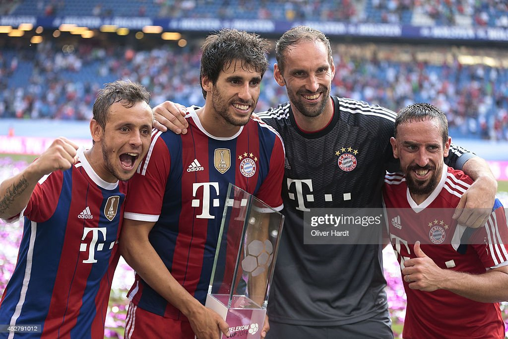 Rafinha,Tom Stark and Javi Martinez,Frank Ribery (L-R) of Munich celebrates with the trophy after the Telekom Cup 2014 Finale match between FC Bayern Muenchen and Borussia Moenchengladbach at Imtech Arena on July 27, 2014 in Hamburg, Germany.