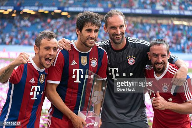 RafinhaTom Stark and Javi MartinezFrank Ribery of Munich celebrates with the trophy after the Telekom Cup 2014 Finale match between FC Bayern...
