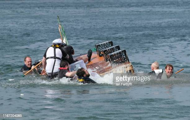 A raft capsizes during a raft race at the annual Whitby Regatta on August 10 2019 in Whitby England At over 170 years old the Whitby Regatta is...