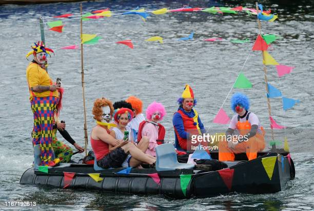 A raft carrying people dressed as clowns floats through the harbour during the annual Whitby Regatta on August 10 2019 in Whitby England At over 170...