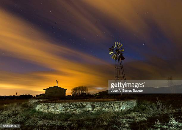 raft of irrigation and windmill in the night - american style windmill stock pictures, royalty-free photos & images