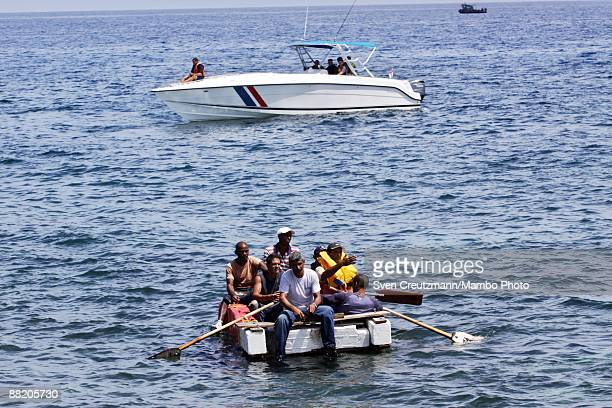 Rafters are detained by Cuban security officers after seven men failed in an attempt to leave the island at the Malecon waterfront on June 4 2009 in...