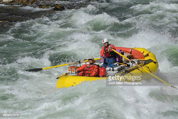 Rafters pushing through a rapid on the Colorado River