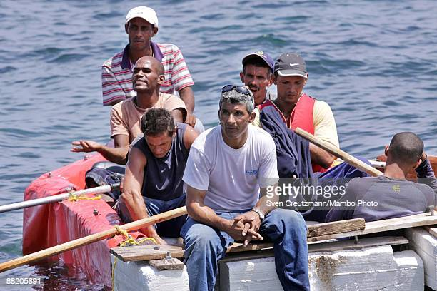 Rafters talk with Cuban security officers after they failed in an attempt to leave the island at the Malecon waterfront on June 4 2009 in Havana Cuba...