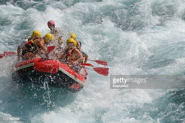 Rafting on white water in a storm
