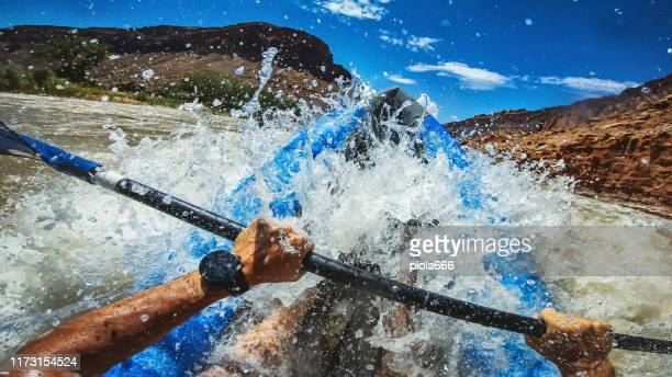 pov  rafting with kayak in colorado river, moab - rafting stock pictures, royalty-free photos & images