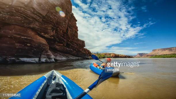 pov  rafting with kayak in colorado river, moab - colorado river stock pictures, royalty-free photos & images