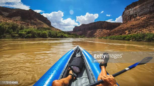 pov  rafting with kayak in colorado river, moab - moab utah stock pictures, royalty-free photos & images
