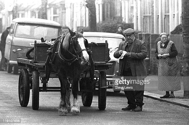 A rag and bone man with his horse and cart on a street in east London circa 1970