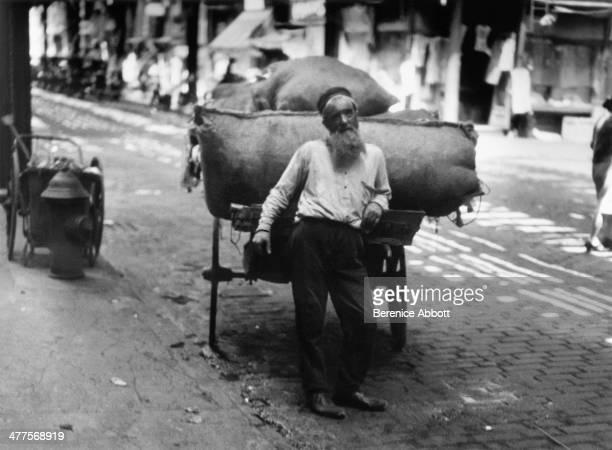 Rag Merchant Under the Elevated Lower Manhattan New York City New York circa 1930