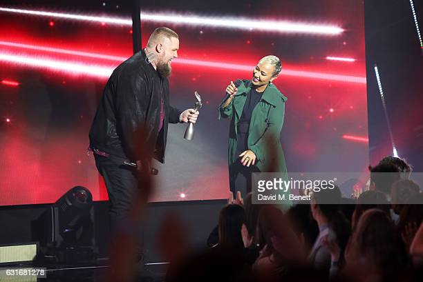 Rag 'n' Bone Man accepts the Critics' Choice award from Emeli Sande onstage at The BRIT Awards with Mastercard 2017 nominations show at ITV Studios...