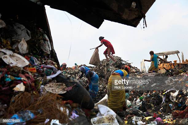 Rag pickers, as they are called, scavenge for food and recyclable materials inside Delhis 70–acre, 100–foot high Ghazipur landfill. A vile stench...