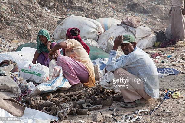 Rag pickers sit with sorted bones and buffalo horns at the Ghazipur landfill site in the east of New Delhi India on Friday May 30 2014 New Delhi...