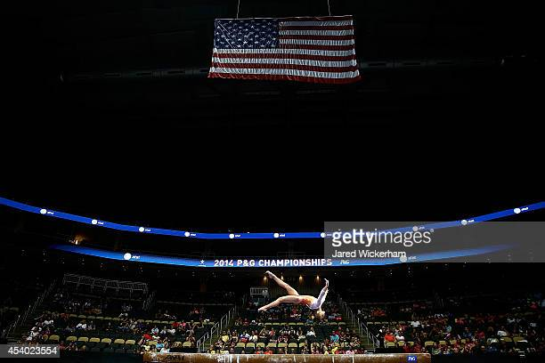 Ragan Smith competes on the balance beam in the junior women finals during the 2014 PG Gymnastics Championships at Consol Energy Center on August 23...