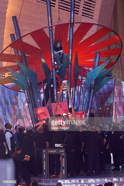 Rage Against the Machine bass player Tim Commerford sits on part of the set at the 2000 MTV Video Music Awards at radio City Music Hall in new York...