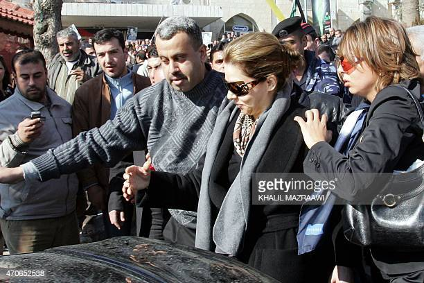 Raghad Saddam Hussein the daughter of executed ousted Iraqi president Saddam Hussein is supported by her friends to reach her car after attending a...