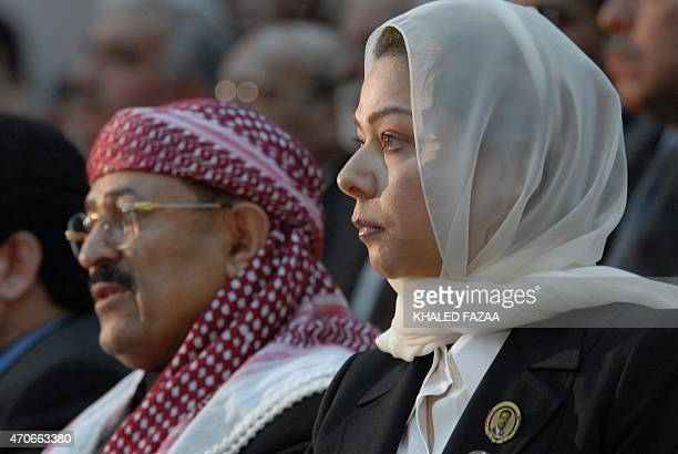 Raghad the daughter of Iraq's late former president Saddam Hussein sits next to Yemen's Baath Party leader Qassem Sallam during a memorial service...