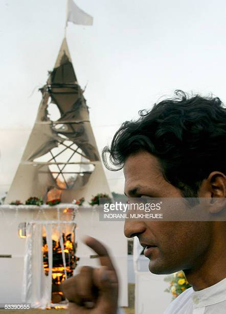 Raghavan Kadirgamar son of slain Sri Lankan Foreign Minister Lakshman Kadirgamar looks on as his father's funeral pyre burns in Colombo 15 August...