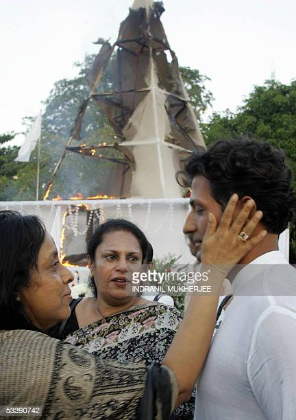 Raghavan Kadirgamar son of slain Sri Lankan Foreign Minister Lakshman Kadirgamar is consoles by female reatives as they stand in front of his...
