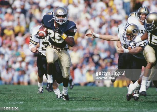 Raghib Ismail, Wide Receiver for the Notre Dame Fighting Irish runs the football during the NCAA Big Ten Conference college football game against the...