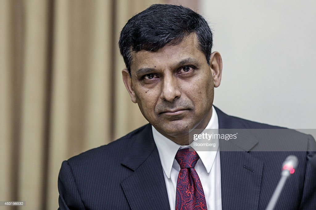 Reserve Bank of India Governor Rajan Unveils Interest-Rate Decision And Images Of Market Reactions : News Photo