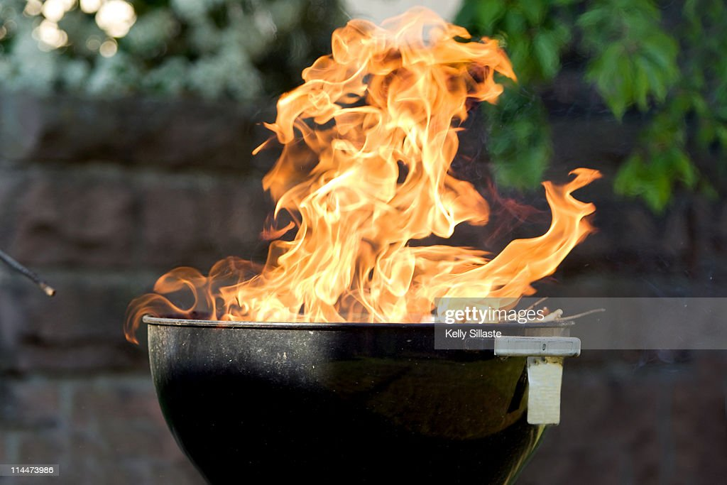 Raging fire from charcoal barbecue grill : Stock Photo