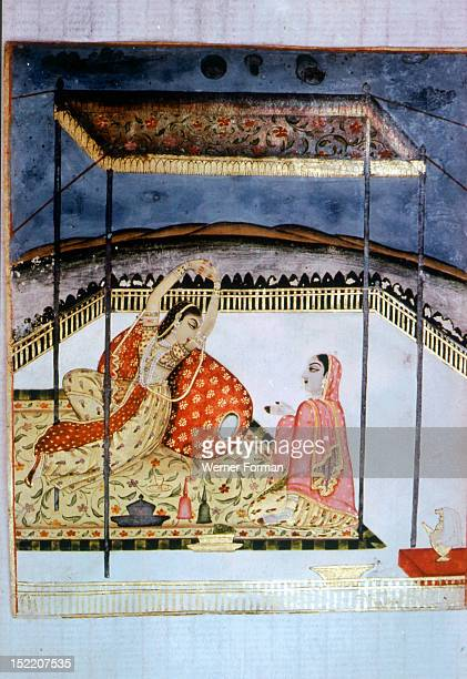 Ragini Varari from a series of Ragamalas The heroine accompanied by a servant rests under a canopy Her pose expresses the theme of sensual love and...