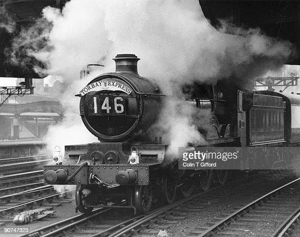 Raglan Castle' steam locomotive leaving Paddington Station in London. Castle class 4-6-0 No 5008 'Raglan Castle' bursts from under Bishops Bridge as...