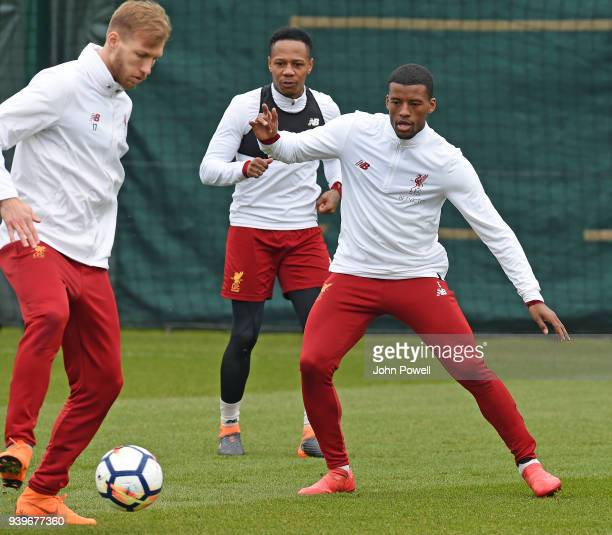 Ragnar Klavan and Georginio Wijnaldum of Liverpool during a training session at Melwood Training Ground on March 29 2018 in Liverpool England