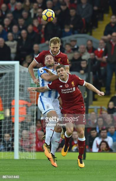 Ragnar Klavan and James Milner of Liverpool with Laurent Depoitre during the Premier League match between Liverpool and Huddersfield Town at Anfield...