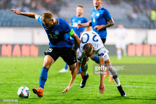Ragnar Klavan and Jasse Tuominen with the ball during the UEFA Nations League football match between Finland and Estonia at the Veritas Stadium in...