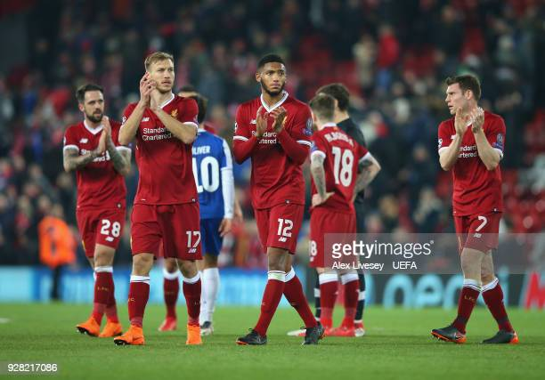 Ragnar Klavan and Joe Gomez of Liverpool applaud their supporters after the UEFA Champions League Round of 16 Second Leg match between Liverpool and...
