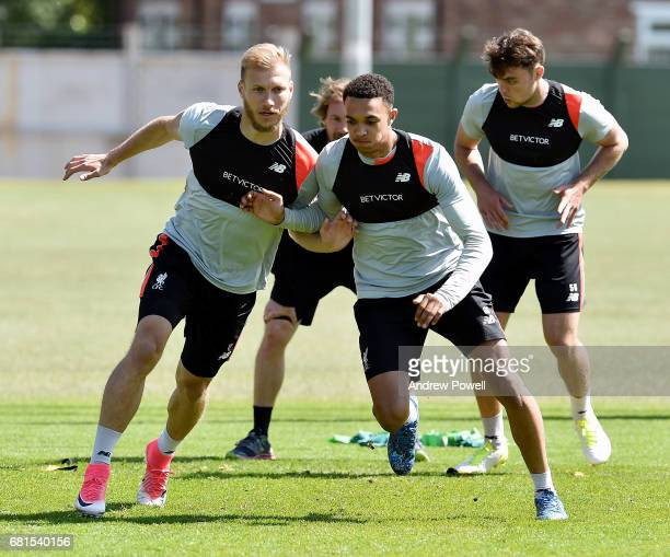Ragnar Klavan and Trent AlexanderArnold of Liverpool during a training session at Melwood Training Ground on May 10 2017 in Liverpool England